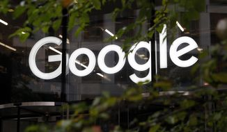 This Nov. 1, 2018, file photo shows a photo of the Google logo at their offices in Granary Square, London. The European Court of Justice's ruled Tuesday, Sept. 24, 2019, that there is no obligation under EU law, for a search engine operator to extend beyond the EU member states the court's 2014 ruling that people have the right to control what appears when their name is searched online. (AP Photo/Alastair Grant, File)