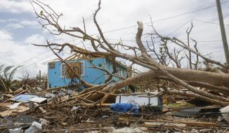 In this Sept. 19, 2019 photo, buildings in Marsh Harbor on the island of Abaco in the Bahamas, are devastated by the effects of Hurricane Dorian. Many Bahamian schools remain closed weeks after the storm due to a lack of clean water. (Chris Day/Fresh Take Florida, University of Florida via AP)