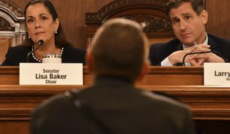 Pennsylvania's Senate Judiciary Committee chairwoman, Republican Lisa Baker, left, and the committee's ranking Democrat, Larry Farnese, listen during testimony in a hearing on firearms related issues, Tuesday, Sept. 24, 2019 in Harrisburg, Pa. (AP Photo/Marc Levy)