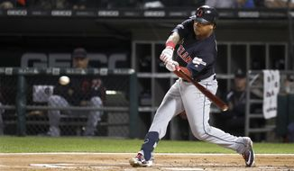 Cleveland Indians Jose Ramirez swings for a grand slam off Chicago White Sox's Carson Fulmer during the first inning of a baseball game Tuesday, Sept. 24, 2019, in Chicago. (AP Photo/Charles Rex Arbogast)