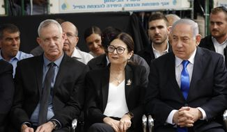 In this Thursday, Sept. 19, 2019, file photo, Blue and White party leader Benny Gantz, left, Esther Hayut, the Chief Justice of the Supreme Court of Israel, and Prime Minister Benjamin Netanyahu attend a memorial service for former President Shimon Peres in Jerusalem. (AP Photo/Ariel Schalit, File)