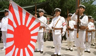 FILE - In this Aug. 15, 1999, file photo, Japanese war veterans in Japan's Imperial Navy uniform stand at attention with the navy flag as they pay their respects to the war dead at Tokyo's Yasukuni Shrine to commemorate the 54th anniversary of the end of World War II. Japan has announced it is not inviting South Korea to an upcoming multinational naval review it is hosting next month because their ties are badly strained over history, trade and defense. (AP Photo/Tsugufumi Matsumoto, File)