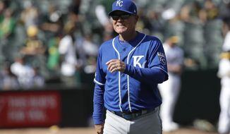 Kansas City Royals manager Ned Yost walks to the dugout after making a pitching change during the ninth inning of a baseball game between the Oakland Athletics and the Royals in Oakland, Calif., Wednesday, Sept. 18, 2019. (AP Photo/Jeff Chiu)