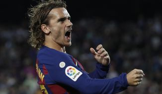 Barcelona's Antoine Griezmann celebrates after scoring the opening goal during the Spanish La Liga soccer match between FC Barcelona and Villarreal CF at the Camp Nou stadium in Barcelona, Spain, Tuesday, Sep. 24, 2019. (AP Photo/Joan Monfort)