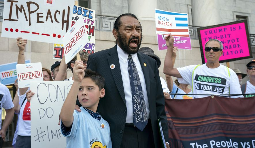 Rep. Al Green, D-Texas, joins impeachment activists with a youth-led group, By The People, to call for Congress to remove President Donald Trump from office, outside the Rayburn House Office Building on Capitol Hill in Washington, Monday, Sept. 23, 2019. Rep. Green, joined by Alex Meltzer, 9, of Boston, has pressed for Trump's impeachment three times. (AP Photo/J. Scott Applewhite)