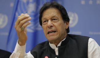 Imran Khan, Prime Minister of Pakistan, speaks to reporters during a news conference at United Nations headquarters Tuesday, Sept. 24, 2019. (AP Photo/Seth Wenig)