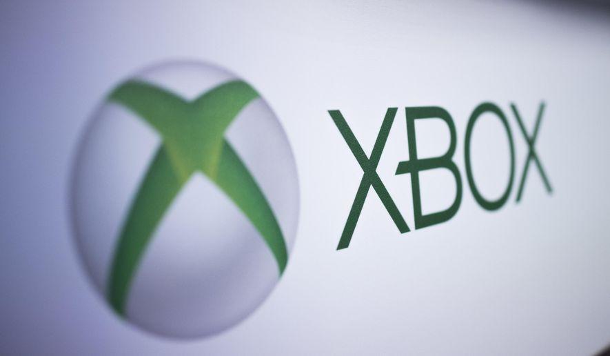 This Nov. 3, 2017, file photo shows the logo Xbox at the Paris Games Week in Paris.  (AP Photo/Kamil Zihnioglu)  **FILE**