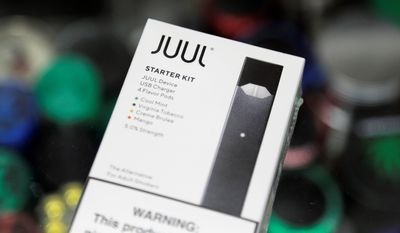 Juul Labs CEO Kevin Burns has stepped down and will be replaced by K.C. Crosthwaite. (Associated Press)