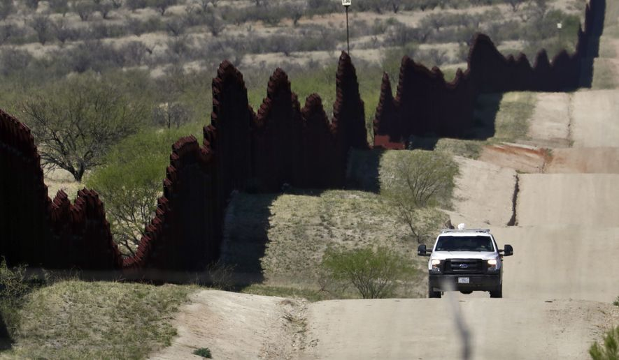 In this April 10, 2018, file photo, a Customs and Border Patrol agent patrols the international border near Nogales, Ariz. (AP Photo/Matt York, file)