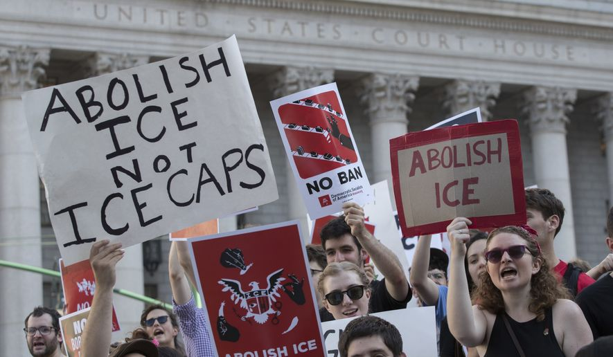 Protester chant slogans outside a Federal court during a demonstration calling for the abolishment of Immigration and Customs Enforcement, or ICE, and an end to mass incarceration, Friday, June 29, 2018, in New York. (AP Photo/Mary Altaffer) **FILE**