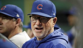 Chicago Cubs manager Joe Maddon stands in the dugout during the first inning of a baseball game against the Pittsburgh Pirates in Pittsburgh, Wednesday, Sept. 25, 2019. (AP Photo/Gene J. Puskar) ** FILE **
