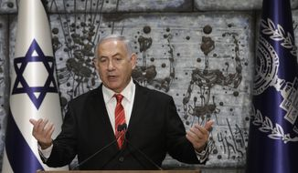 Israeli Prime Minister Benjamin Netanyahu gives a statement in Jerusalem, Wednesday, Sept. 25, 2109. The office of Israeli President Reuven Rivlin said Netanyahu has been given the task of forming a new government. (AP Photo/Sebastian Scheiner)