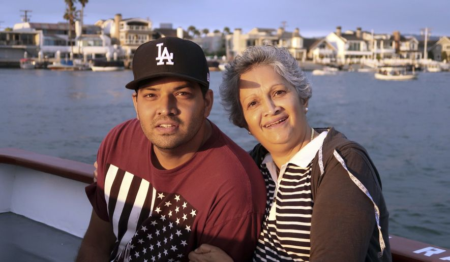 This undated file photo provided by Louana D'Cunha shows Kenneth French and his mother, Paola French. A grand jury has declined to bring charges against an off-duty Los Angeles police officer who fatally shot Kenneth French during an altercation in a Southern California Costco warehouse. Riverside County District Attorney Mike Hestrin announced the grand jury's decision Wednesday, Sept. 25, 2019.  (Louana D'Cunha via AP, File) **FILE**