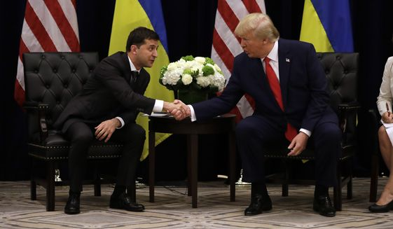 President Donald Trump meets with Ukrainian President Volodymyr Zelensky at the InterContinental Barclay New York hotel during the United Nations General Assembly, Wednesday, Sept. 25, 2019, in New York. (AP Photo/Evan Vucci) ** FILE **