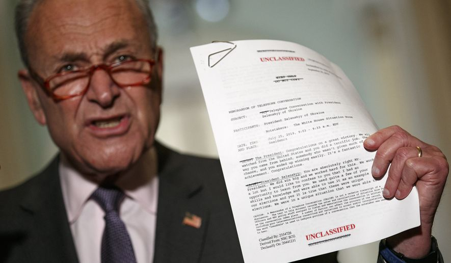 Senate Minority Leader Sen. Chuck Schumer of N.Y. holds up a copy of a released transcript of a phone call between President Donald Trump and the President of Ukraine as Schumer speaks to the media about an impeachment inquiry on President Trump, Wednesday Sept. 25, 2019, on Capitol Hill in Washington. (AP Photo/Jacquelyn Martin)