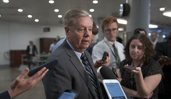 Senate Judiciary Committee Chairman Lindsey Graham, R-S.C., takes questions from reporters at the Capitol in Washington, Wednesday, Sept. 25, 2019. (AP Photo/J. Scott Applewhite) ** FILE **