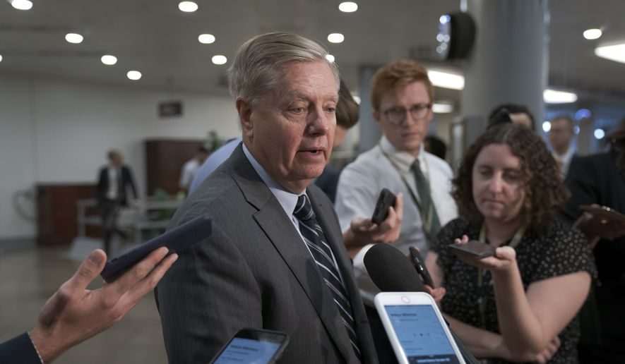 Senate Judiciary Committee Chairman Lindsey Graham, R-S.C., takes questions from reporters following a closed-door briefing on Iran, at the Capitol in Washington, Wednesday, Sept. 25, 2019. (AP Photo/J. Scott Applewhite) ** FILE **