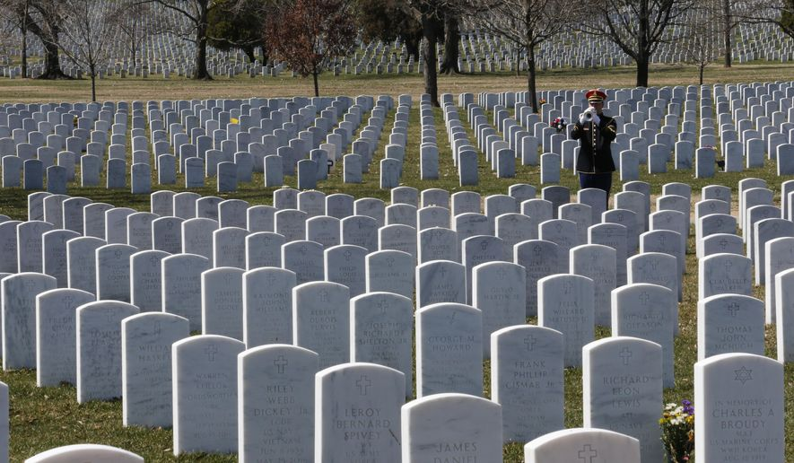 A military bugler plays taps during a funeral at Arlington National Cemetery in Arlington, Va.  (AP Photo/Steve Helber, File)