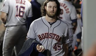 Houston Astros starting pitcher Gerrit Cole carries a game ball toward the clubhouse after the seventh inning against the Seattle Mariners, Tuesday, Sept. 24, 2019, in Seattle. Cole broke the Astros' franchise record for strikeouts in a season. (AP Photo/Ted S. Warren)