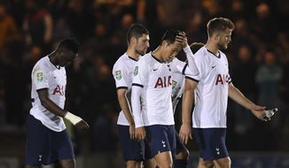 Tottenham Hotspur's Son Heung-min, second from right, and his teammates react during an English League Cup soccer match between Tottenham Hotspur and Colchester United, Tuesday, Sept. 24, 2019, at JobServe Community Stadium in Colchester, England. (Joe Giddens/PA via AP)