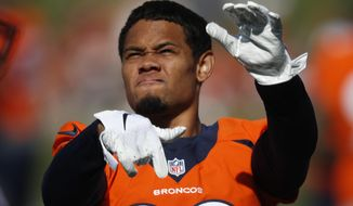 FILE - In this July 18, 2019, file photo, Denver Broncos cornerback Bryce Callahan (29) takes part in drills at the team's NFL football training camp in Englewood, Colo. Callahan will miss at least another month after undergoing a medical procedure Wednesday, Sept. 25, 2019, on his surgically-repaired left foot. Coach Vic Fangio said Callahan, who has yet to make his Denver debut, will miss 4-to-6 weeks and a full-fledged second surgery is still a possibility as is a trip to injured reserve. The Broncos (0-3) had big plans for Callahan when they signed him to a three-year, $21 million deal in the offseason.(AP Photo/David Zalubowski, File)