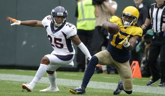 Green Bay Packers wide receiver Davante Adams (17) catches a pass as Denver Broncos cornerback Chris Harris defends during the first half of an NFL football game Sunday, Sept. 22, 2019, in Green Bay, Wis. (AP Photo/Mike Roemer)