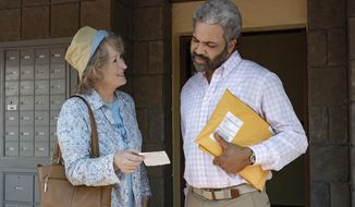 "This image released by Netflix shows Meryl Streep, left, and Jeffrey Wright in a scene from ""The Laundromat,"" in theaters on Sept. 27. (Claudette Barius/Netflix via AP)"