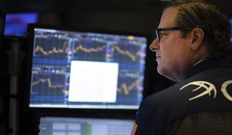 In this Sept. 18, 2019, file photo a stock trader works at the New York Stock Exchange. The U.S. stock market opens at 9:30 a.m. EDT on Wednesday, Sept. 25. (AP Photo/Mark Lennihan, File) **FILE**