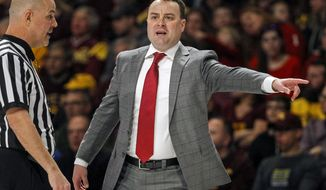 FILE - In this Saturday, Feb. 16, 2019 file photo, Indiana head coach Archie Miller yells to his team during an NCAA college basketball game against Minnesota in Minneapolis. Coach Archie Miller expects the Indiana Hoosiers to look and play differently this season. He has a bigger, stronger, more experienced roster. He expects better ball movement. And it all starts with more communication. (AP Photo/Bruce Kluckhohn, File)