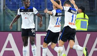 Atalanta's Duvan Zapata, left, celebrates with his teammates after he scored his side's first goal during a Serie A soccer match between Roma and Atalanta, at Rome's Olympic stadium, in Rome, Wednesday, Sept. 25, 2019. (Ettore Ferrari/ANSA via AP)
