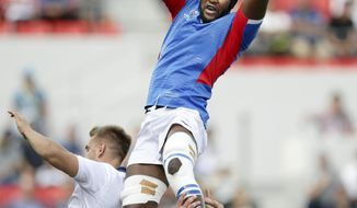 Namibia's Tjiuee Uanivi catches the ball to to win a lineout against Italy during the Rugby World Cup Pool B game between Italy and Namibia in Osaka, western Japan, Sunday, Sept. 22, 2019. (Yohei Fukuyama/Kyodo News via AP)