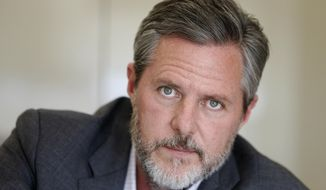 In this Nov. 16, 2016 file photo Liberty University president Jerry Falwell Jr., pauses during an interview in his office at the school in Lynchburg, Va.  (AP Photo/Steve Helber, File) **FILE**