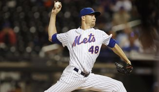New York Mets starting pitcher Jacob deGrom winds up during the first inning of the team's baseball game against the Miami Marlins, Wednesday, Sept. 25, 2019, in New York. (AP Photo/Kathy Willens)