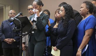 Jazmyne Childs cries during a news conference on Wednesday, Sept. 25, 2019, as she describes the sexual harassment she says she endured while employed by the North Carolina chapter of the NAACP, in Raleigh, N.C. She is asking the national NAACP to expel the man whom she identified as the person who assaulted and harassed her. (AP Photo/Martha Waggoner)