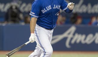Toronto Blue Jays' Rowdy Tellez hits a home run against the Baltimore Orioles during the sixth inning of a baseball game, Wednesday, Sept. 25, 2019 in Toronto,  (Fred Thornhill/The Canadian Press via AP)