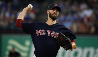 Boston Red Sox starting pitcher Rick Porcello throws to the Texas Rangers in the first inning of a baseball game in Arlington, Texas, Wednesday, Sept. 25, 2019. (AP Photo/Tony Gutierrez)