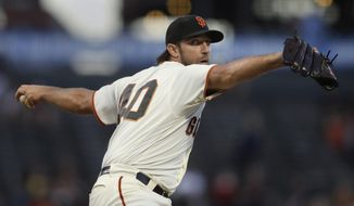 San Francisco Giants pitcher Madison Bumgarner works against the Colorado Rockies during the first inning of a baseball game Tuesday, Sept. 24, 2019, in San Francisco. (AP Photo/Ben Margot) ** FILE **
