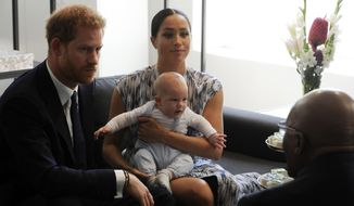 Britain's Prince Harry and Meghan, Duchess of Sussex, holding their son Archie, meet with Anglican Archbishop Emeritus, Desmond Tutu in Cape Town, South Africa, Wednesday Sept. 25, 2019. The royal couple are on the third day of their African tour. (Henk Kruger/African News Agency via AP, Pool)