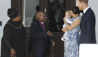 Britain's Prince Harry and Meghan, Duchess of Sussex, holding their son Archie, meet with Anglican Archbishop Emeritus, Desmond Tutu, and his wife Leah in Cape Town, South Africa, Wednesday, Sept. 25, 2019. The royal couple are on the third day of their African tour. (Henk Kruger/African News Agency via AP, Pool)