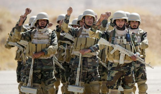 Syrian soldiers prepare to take part in military exercises led by Russian military advisers at a military base about 50-kilometers away from Damascus, Syria, Tuesday, Sept. 24, 2019. (AP Photo/Alexander Zemlianichenko)