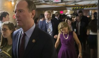 Rep. Adam Schiff, D-Calif., left, Chairman of the House Intelligence Committee departs with other House democrats after a caucus meeting, Tuesday, Sept. 24, 2019 in Washington. (AP Photo/Alex Brandon)