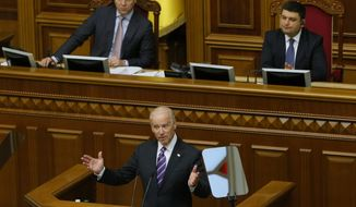 FILE In this file photo taken on Tuesday, Dec. 8, 2015, U.S. Vice President Joe Biden addresses the Ukraine Parliament in Kyiv, Ukraine. Ukrainian President Volodymyr Zelenskiy's first 100 days in power were marked by his efforts to advance a peaceful solution to the armed conflict in the country's east, fomented by Russia. Now, he is caught up in a political furor involving the United States, Ukraine's ally and backer. (AP Photo/Sergei Chuzavkov, Pool, File)