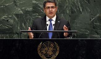 Honduras President Juan Orlando Hernandez Alvarado addresses the 74th session of the United Nations General Assembly, Wednesday, Sept. 25, 2019. (AP Photo/Richard Drew)