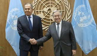 In this photo provided by the United Nations, Sergey V. Lavrov, left, Minister for Foreign Affairs of the Russian Federation, shakes hands with U.N. Secretary General Antonio Guterres at United Nations headquarters during the 74th session of the U.N. General Assembly, Wednesday, Sept. 25, 2019. (Evan Schneider/The United Nations via AP)