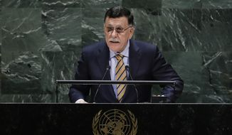 Libya's Prime Minister Fayez al-Sarraj addresses the 74th session of the United Nations General Assembly, Wednesday, Sept. 25, 2019, at the United Nations headquarters. (AP Photo/Frank Franklin II) ** FILE **