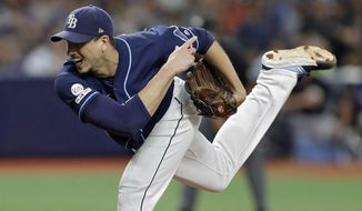 Tampa Bay Rays' Charlie Morton follows through on a pitch to a New York Yankees batter during the fourth inning of a baseball game Wednesday, Sept. 25, 2019, in St. Petersburg, Fla. (AP Photo/Chris O'Meara)