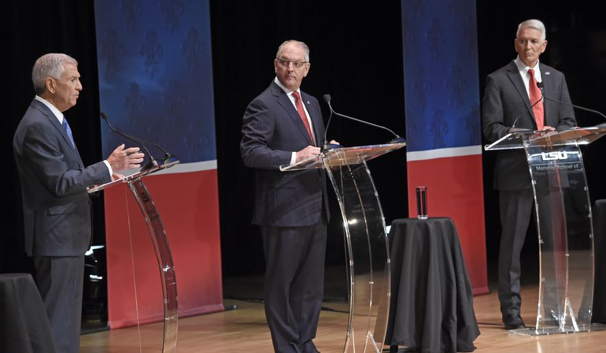 Eddie Rispone, left, responds to a question as Gov. John Bel Edwards, center, and Republican Rep. Ralph Abraham, right, watch as they participate in the first televised gubernatorial debate Thursday Sept. 19, 2019, in Baton Rouge, La. (Bill Feig/The Advocate via AP, Pool)