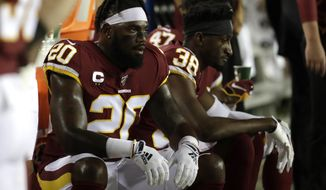 Washington Redskins strong safety Landon Collins looks on from the bench during the first half of an NFL football game against the Chicago Bears Monday, Sept. 23, 2019, in Landover, Md. (AP Photo/Julio Cortez)