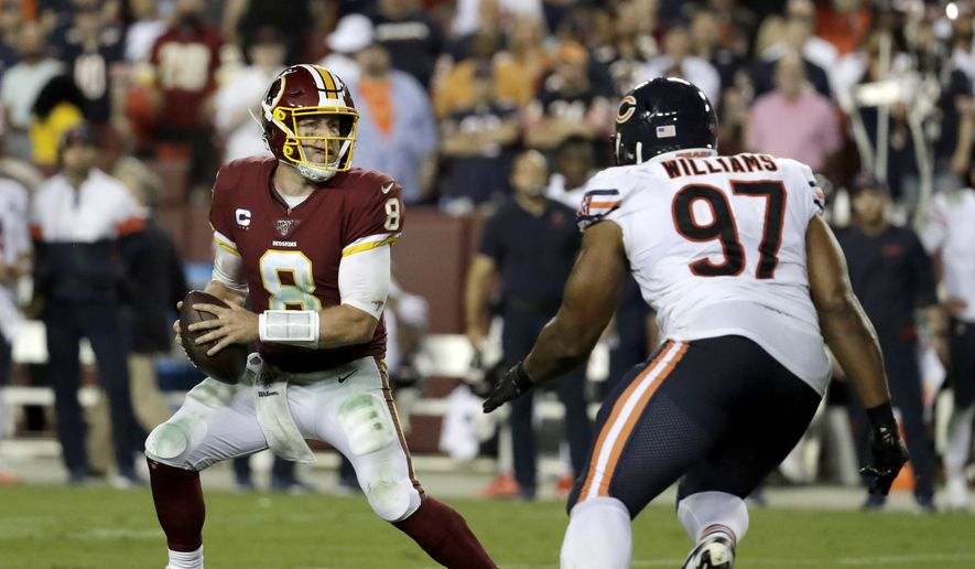 Washington Redskins quarterback Case Keenum (8) tries to avoid a sack from Chicago Bears defensive tackle Nick Williams (97) during the second half of an NFL football game Monday, Sept. 23, 2019, in Landover, Md. The Bears won 31-15. (AP Photo/Julio Cortez) **FILE**