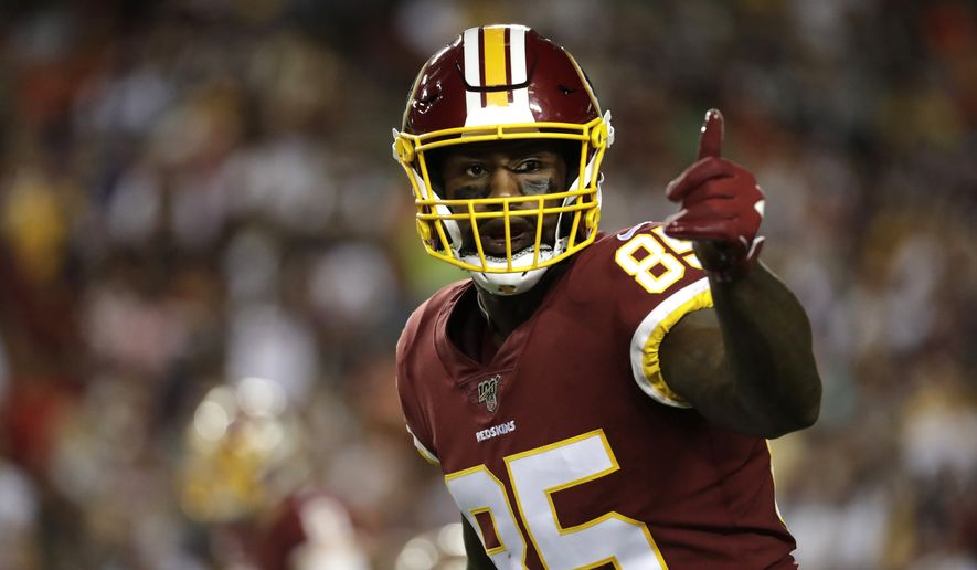 Washington Redskins tight end Vernon Davis gestures toward a line judge during the first half of an NFL football game against the Chicago Bears Monday, Sept. 23, 2019, in Landover, Md. (AP Photo/Julio Cortez) **FILE**